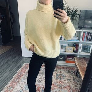 Soft yellow knit turtle neck sweater